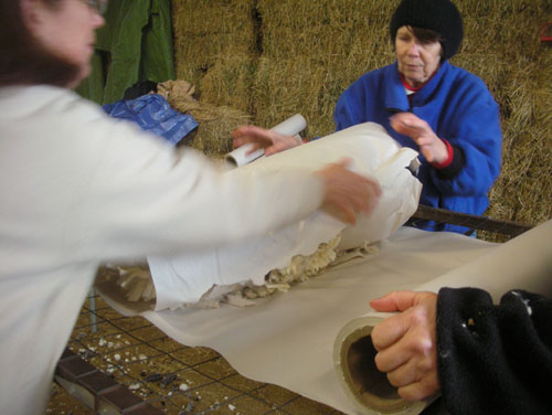 Wrapping the rolled fleece in more paper